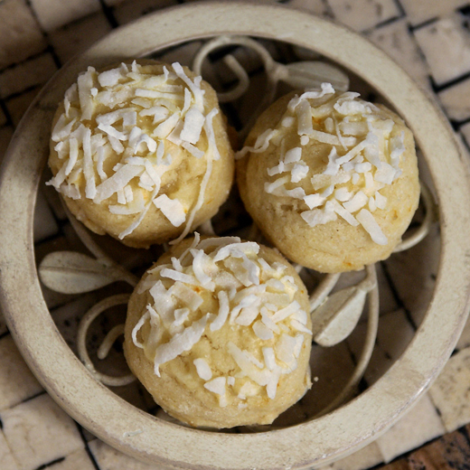 Sadie - orange butter cookie topped with a light glaze and shredded coconut